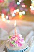 Kerze auf Cupcake foto