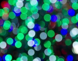 defokussierte Lichter des Weihnachtsbaumes foto