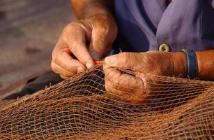 pêcheur au filet (détail) foto