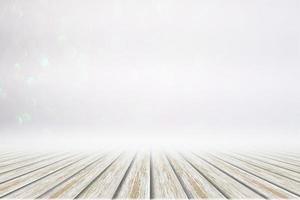 weißer Holzboden auf Bokehhintergrund foto
