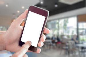 Smartphone-Modell mit verschwommenem Café foto