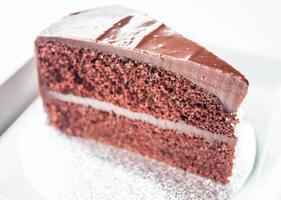 Stück Schokoladenbiskuit foto