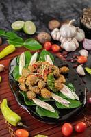 Curry- und sautierte Herzmuscheln foto