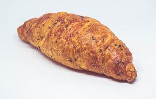 Croissant lokalisiert auf einem weißen Hintergrund foto