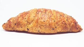 Croissantbrot, Frankreich-Croissant lokalisiert auf weißem Hintergrund foto