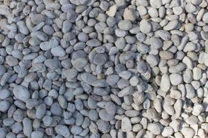 Steinkiesel für Hintergrundbeschaffenheit, Strandsteinmusterhintergrund.