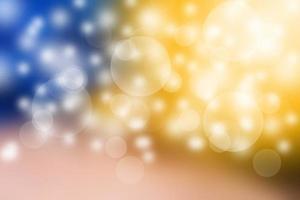 Bokeh auf dem goldenen und blauen Hintergrund foto