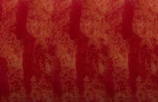 abstrakte rote Hintergrundbeschaffenheit Betonwand