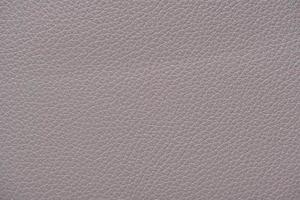 extrem nahe Nahaufnahme hellgraue Leder Textur Hintergrundoberfläche foto