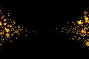 verschwommene goldene Kreise auf schwarzem Hintergrund foto