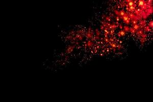 verschwommene rote Kreise mit schwarzem Hintergrund foto