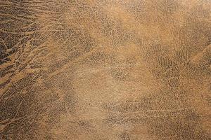 Nahaufnahme von braunem Leder für Textur oder Hintergrund foto