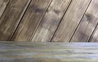 Holztisch und Wand foto