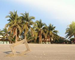 Fotorahmen im Sand am Strand foto