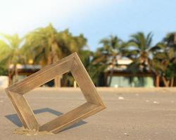 Fotorahmen im Sand foto