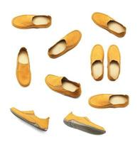 Satz gelbe Schuhe auf Weiß
