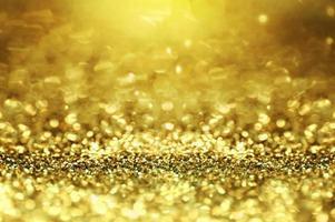 Goldglitter und abstrakter Bokeh-Hintergrund