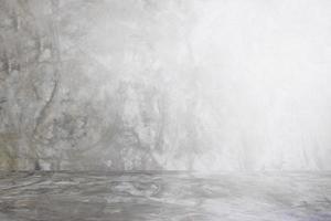 graue Wand des Zementstudiohintergrundes für Präsentationsprodukt foto