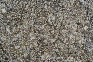Textur von grauem Zement gemischt mit Kies foto