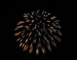 funkelndes goldenes Feuerwerk foto