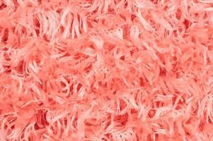 Nahaufnahme des weichen rosa Baumwollteppichs