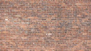 eine rote Backsteinmauer