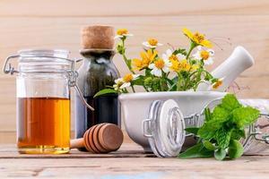 Kräuterkamille und Honig foto
