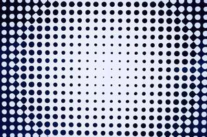 die Textur eines weißen Hintergrunds mit schwarzen Kreisen unterschiedlicher Größe foto