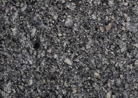 graue Granitstrukturoberfläche und -hintergrund des Natursteins. Material für Dekoration Textur und Innenarchitektur foto