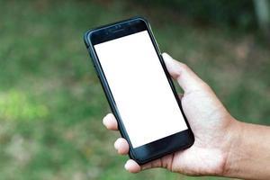 Person, die das Mobiltelefon benutzt foto