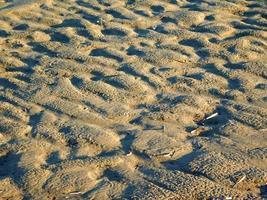 Sandfläche für Hintergrund oder Textur foto