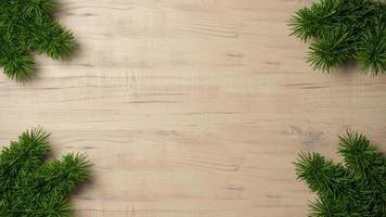Grünfichtenkiefernzweige auf einem hölzernen Hintergrundrahmen foto