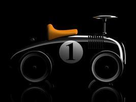 schwarzes Retro-Spielzeugauto Nummer eins lokalisiert auf einem schwarzen Hintergrund