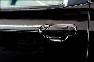 schwarzer Autotürgriff foto