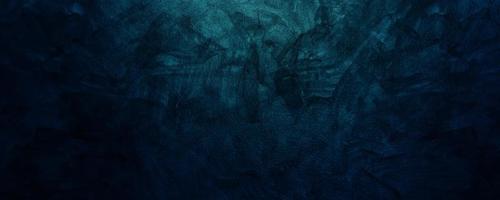 dunkelblauer Zement oder Betonwand für Hintergrund oder Textur foto