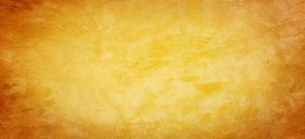 gelber und orange Zement oder Betonwand für Hintergrund oder Textur foto