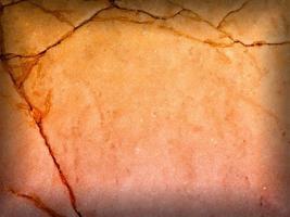 Tafel aus orangefarbenem Marmor mit Vignettenschattenrahmen für Hintergrund oder Textur