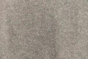 körnige Textur aus grauem Betongranit foto
