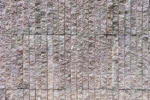 Nahaufnahme der Granitstrukturwand foto