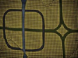 karierte und geometrische Designs auf Stoff für Hintergrund oder Textur foto