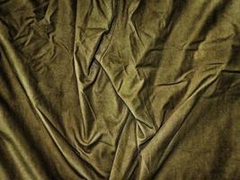 grüner zerknitterter Stoff für Hintergrund oder Textur foto