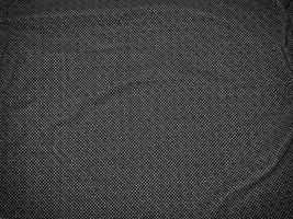 Patch aus grauem Stoff für Hintergrund oder Textur foto