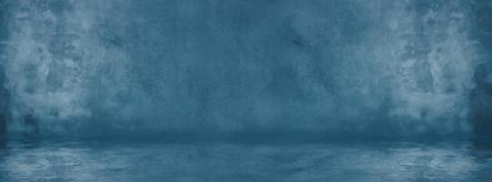 blaue Zementwand mit dunkler Textur und Bannerhintergrundstudio und Ausstellungsraum foto