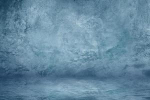 blaue Zement-Studiowand mit dunklem Texturhintergrund für Ausstellungsraum foto