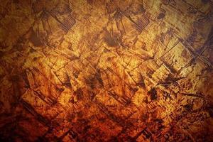 abstrakter Texturhintergrund des dunklen orange und gelben Zements foto