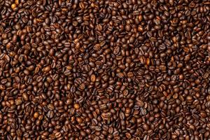 Nahaufnahme von braunem, geröstetem Kaffeebohnenhintergrund foto