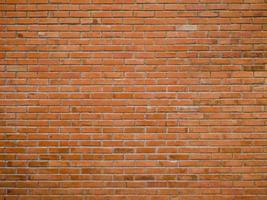 roter Backsteinmauerbeschaffenheitshintergrund foto