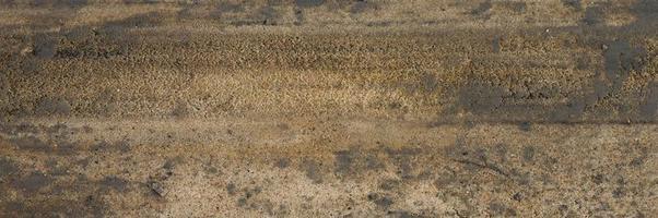 Hintergrundtextur von der glatten Oberfläche des Holzsandes foto