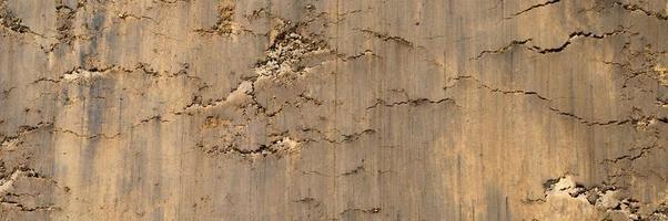 Hintergrundtextur von der losen Oberfläche des Sand- und Erdbodens foto