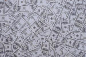 uns 100 Dollarnoten Hintergrund foto